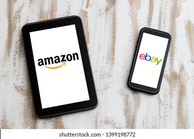Cape Town, South Africa. 15 May 2019. Two mobile smart devices one with logos of Amazon and EBay displayed on screen as a concept of Amazon vs EBay.