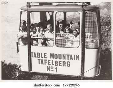 CAPE TOWN, SOUTH AFRICA - 1970's: A group of people heading up to Table Mountain in a cable car