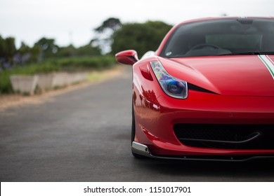 Cape Town, South Africa. 27 December 2015. Red Ferrari 458 Italia on the side of the road.