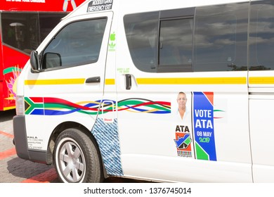 Cape Town, South Africa - April 16, 2019:  South African black taxi with an election campaign poster on the door advertising a political party to vote for on 8th May 2019