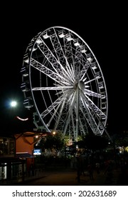 CAPE TOWN, SOUTH AFRICA - APRIL 2. 2014: Night photo of the Ferris wheel at Cape Town harbor front.