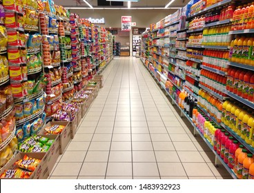 Cape Town, South Africa - AUG 1, 2019: Supermarket shelves stocked with groceries. Concept for South African economy, living standard, income inequality, food prices, living expenses and saving money.