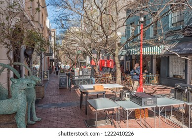 CAPE TOWN, SOUTH AFRICA, AUGUST 17, 2018: View of  a closed-off portion of Church Street in Cape Town. A Restaurant, other businesses and people are visible