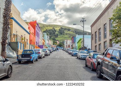 CAPE TOWN, SOUTH AFRICA, AUGUST 17, 2018: A street scene, with multi-colored houses, in the Bo-Kaap in Cape Town in the Western Cape Province. Signal Hill is visible in the back