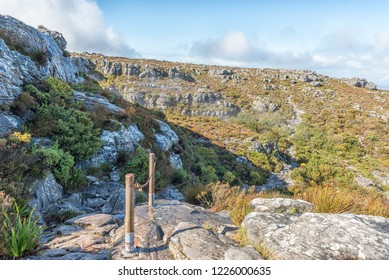 CAPE TOWN, SOUTH AFRICA, AUGUST 17, 2018: The view on top of Table mountain in Cape Town. The chain railing on the trail to Maclears Beacon is visible