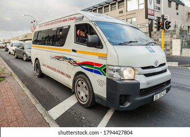 Cape Town, South Africa - August 2020: African Taxi driver driving passengers during Corona Virus Pandemic in South Africa.