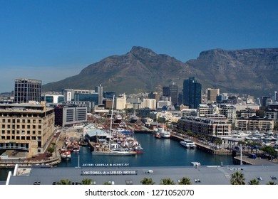CAPE TOWN, SOUTH AFRICA - CIRCA OCTOBER 2018: Dry dock at the V&A Waterfront with downtown Cape Town and Table Mountain in the background