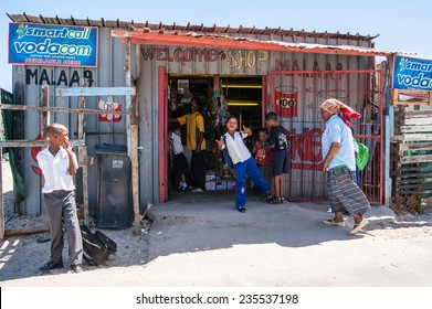 Cape Town, South Africa - circa February 2013, children play and pose for the camera outside a shop in a South African township