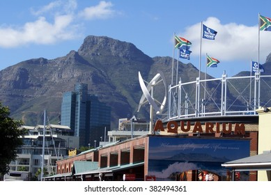CAPE TOWN, SOUTH AFRICA - CIRCA FEBRUARY 2014:Aquarium and other attractions at the Victoria and Alfred Waterfront with Table Mountain in the background