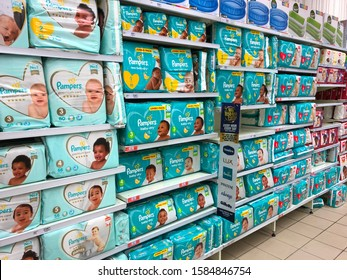 Cape Town, South Africa - Dec 10, 2019: Nappies (or diapers) on retail display. Concept for new parents, expenses, cost of living, baby item prices or saving money. Nappies must be in the baby budget.
