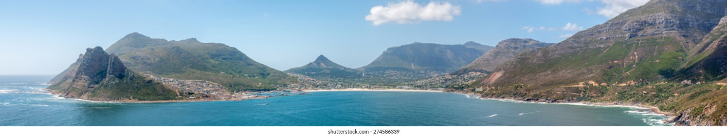 CAPE TOWN, SOUTH AFRICA - DECEMBER 12, 2014:  Panorama of Hout Bay harbor and town. Chapmans Peak Drive is visible to the right