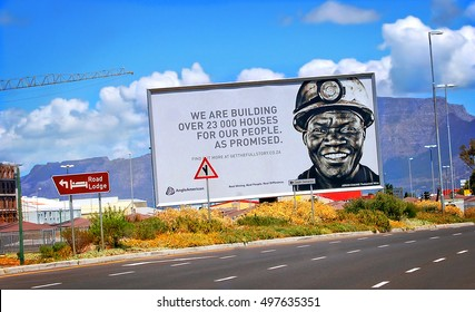 Cape Town, South Africa - December 25,2012: Reconstruction and Development Program in South Africa. Billboard in Cape Town: We are building over 23,000 houses for our people. As Promised