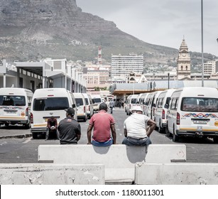 cape Town, South Africa, February 9, 2018: Taxi drivers taking a break on the upper deck of Cape Town Station near Civic Centre in Cape Town, South Africa