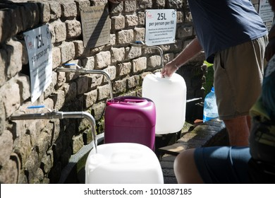 Cape Town / South Africa - January 25, 2018: Lines of people waiting to collect natural spring water for drinking in Newlands in the drought in Cape Town South Africa