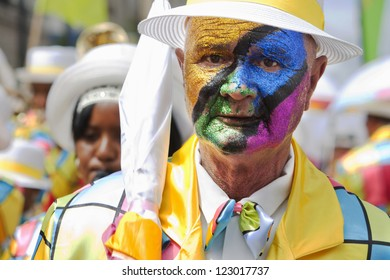 CAPE TOWN, SOUTH AFRICA. JANUARY 2: Street performer with his face painted in the Minstrel Carnival, also known as Kaapse Klopse, on January 2, 2012 in Cape Town, South Africa.
