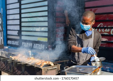 Cape Town, South Africa - June 2020: African Street Food Vendor Wearing Protective Mask, Barbecue Grilled Chicken, Covid 19, Corona Virus, Reopen.
