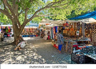 Cape Town, South Africa - March 02, 2017: Traders from across African Continent selling their wares from colourful stalls at Greenmarket Square in Cape Town.