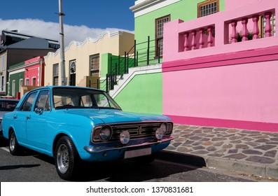 Cape Town, South Africa, March 2019. Vintage Ford Cortina parked outside house in the Malay Quarter, Bo-Kaap, Cape Town, historical area of brightly painted houses housing largely Muslim families.