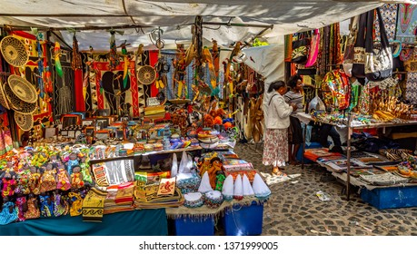 Cape Town, South Africa- March 13, 2019: Local market in South Africa. handmade colorful beads bracelets, bangles. Craftsmanship. African fashion.