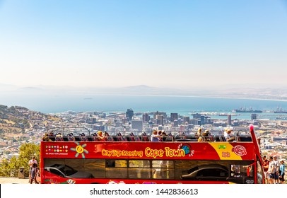 CAPE TOWN ,SOUTH AFRICA - March   16,2015 : Tourist hop on hop off tour bus at Table Mountain. Panoramic view of Cape Town.