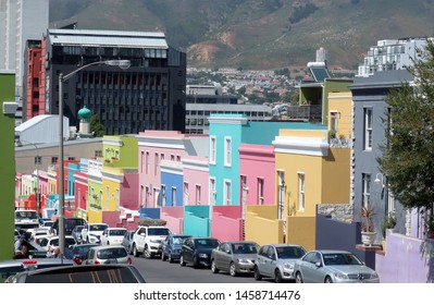 Cape Town, South Africa - March 9, 2019: Street view of colorful houses in Bo Kaap. The neighborhood experiences gentrification, overcrowding, rising property taxes and a housing shortage crisis.