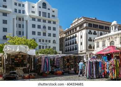 Cape Town, South Africa - March 02, 2017: Traders from across the African continent selling their wares from colourful stalls at Greenmarket square in Cape Town.