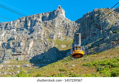 CAPE TOWN, SOUTH AFRICA - MAY 3, 2018: A cable car with tourists climbing up to the Table Mountain national park, Cape Town, South Africa.