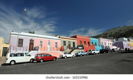 CAPE TOWN, SOUTH AFRICA - MAY 1: City worker's cars parked in Wale Street in Bo Kaap, a district formerly known as the Malay Quarter, in Cape Town, South Africa, on May 1, 2013.