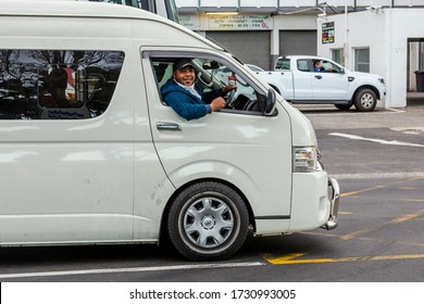 Cape Town, South Africa - May 2020: Friendly South African Taxi Driver wearing face mask during Corona Virus Pandemic in Africa. Minibus Taxi Driver Smiles.
