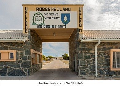 Cape Town, South Africa - May 14, 2015: People walking into Robben Island Prison where Nelson Mandela was imprisoned, now a museum, Cape Town, South Africa as viewed at the entry gate.