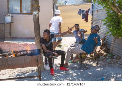 CAPE TOWN, SOUTH AFRICA - NOVEMBER, 2018: Local people in Imizamo Yethu township in Hout Bay, Cape Town