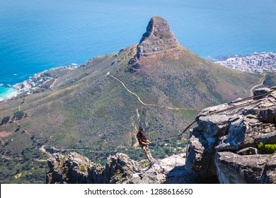 CAPE TOWN, SOUTH AFRICA - NOVEMBER, 2018: Abseiling instructor on the top of Table Mountain in Cape Town