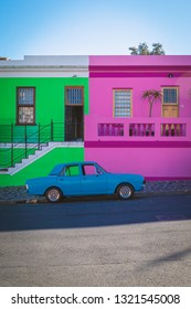 CAPE TOWN, SOUTH AFRICA - NOVEMBER, 2018: Bo Kaap colorful houses and blue retro car in Cape Town