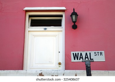 CAPE TOWN, SOUTH AFRICA, NOVEMBER 26: Colorful house in Bo-Kaap with street sign. It is an area of Cape Town, South Africa formerly known as the Malay Quarter. South Africa 2006