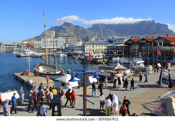 CAPE TOWN, SOUTH AFRICA - NOVEMBER 24, 2011 - Victoria and Alfred Waterfront, harbor with recreation boats, shops, restaurants and Table Mountain on background in Cape Town, South Africa.