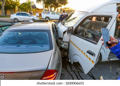 Cape Town, South Africa - October 2020: South African Taxi causes bad mtor vehicle accident. Fire and Rescue on the scene.