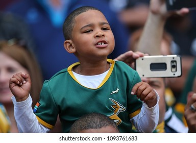 CAPE TOWN, SOUTH AFRICA - Saturday 7 October 2017,  a young spectator sings the national anthem as his sits on top of his father's shoulder, during the Castle Lager Rugby Championship Test.