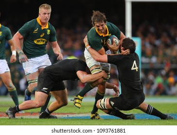 CAPE TOWN, SOUTH AFRICA - Saturday 7 October 2017, Eben Etzebeth (captain) of South Africa runs into Samuel Whitelock of New Zealand during the Castle Lager Rugby Championship Test