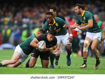 CAPE TOWN, SOUTH AFRICA - Saturday 7 October 2017, Rieko Ioane of New Zealand is tackled by Malcolm Marx, Siya Kolisi and Dillyn Leyds of South Africa during the Castle Lager Rugby Championship Test