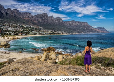 Cape Town, South Africa - woman looks out over the mountains of the Twelve Apostles