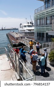 Cape Town  waterfront Western Cape South Africa. December 2017. Tourists at the Nelson Mandela Gateway wait to board a ferry to Robben Island