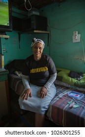 Cape Town, Western Cape, South Africa - November 5 2017 : African woman sitting in her room in Langa Township,  Cape Town