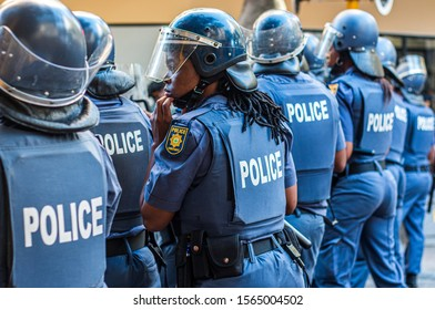 Cape town, Western Cape/ South Africa-February 10,2017: Demonstrators protesting government corruption march through Central Cape Town, watched closely by large police presence.