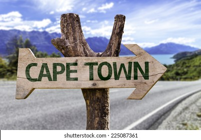 Cape Town wooden sign with a beach on background