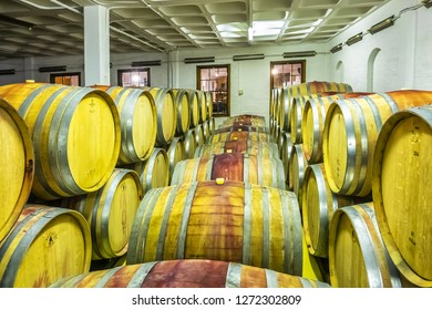 CAPE TOWNE, SOUTH AFRICA - JULY 15, 2018: Zevenwacht Wine Estate located in Kuils River, Cape Town, on the spectacular Stellenbosch Wine Route. Typical oak wine barrels in cellar.