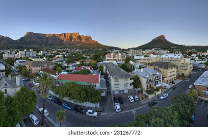 Cape Town's city suburb, known as 'Gardens' in the heart of the CBD, as the sun rises early on a summers morning. Table Mountain, Signal Hill and Lions Head peaks in the background.