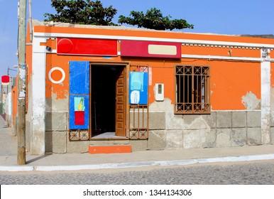 CAPE VERDE ISLANDS, AFRICA - December 21, 2017. Front view of small grocery store and mini market with open door in old neighborhood street.