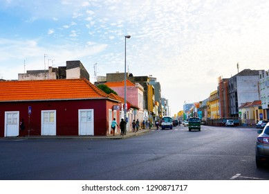Cape Verde, Praia capital city, Plateau District main street. November, 2016. Downtown area of Santiago island with people walking by and entering some collective public transport vans.