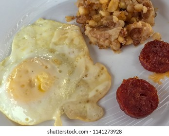 Cape Verdean breakfast of cachupa, fried egg and spicy sausage