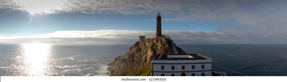 cape vilan with one of the oldest lighthouses on the coast of death (costa da morte) in galicia, spain